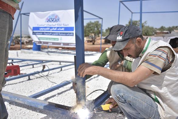 تبرعات أهالي الفريديس تساهم في بناء مساكن للاجئين السوريين